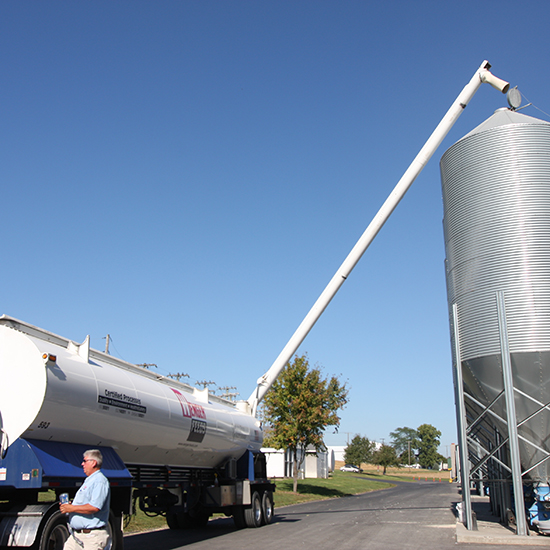 A boom being moved to the feed bin opening.