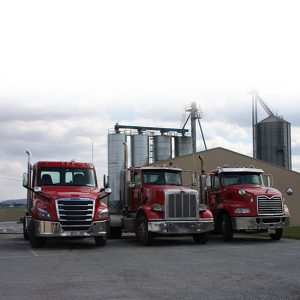 Three Wenger Feed Tractors.
