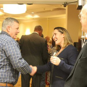 Board Member Abby Lowry greets guests